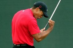 This is an example of the double fist pump where both arms get involved in the action. Here, Tiger seems more concerned with pumping himself up and less ...