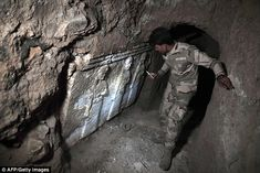 Archaeologists assessing the damage caused by Islamic State militants to the tomb of the p...