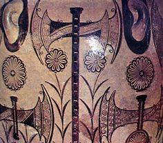 Detail from amphora showing labrys with rosettes. The pot lugs appear as ears flanking the symbol of the Cretan goddess.