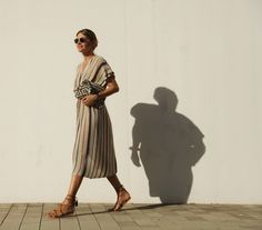 Striped metallic knitted midi dress+brown lace up flat sandals+ethnic clutch+sunglasses. Summer outfit 2016