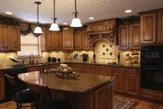 Kitchen...love the island and black appliances