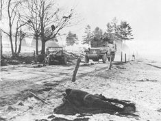 4TH ARMORED DIVISION ROLLING TOWARD CHAUMONT past the bodies of American soldiers