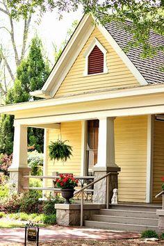 Pretty & cheerful home! Love the Craftsman style porch columns.