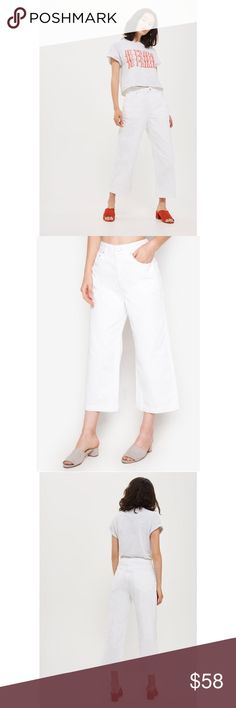 "🎀Topshop MOTO White Cropped Wide Leg Jeans These high-rise MOTO jeans come in a wide leg cropped fit for an on-trend look. Crafted in white non-stretch denim with raw hems, this stylish piece is a new season must-have.   100% Cotton.  Waist 25"" Machine wash. Colour: WHITE  This size currently sold out on website Topshop Jeans Ankle & Cropped"