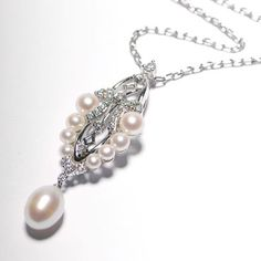 This is such a beatiful pendant & chain made from 925 silver set with cubic zirconia & fresh water pearls.