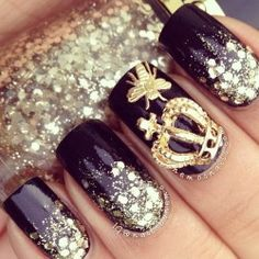 nail art in gold and black glitter and crown
