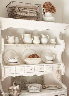 Thoughts from Alice: Farmhouse Touches in the Dining Room - Collection of ironstone pottery on white hutch - neutral fall decor