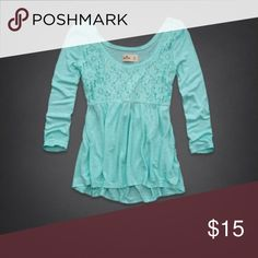 """hollister county line lace panel Aqua babydoll top hollister county line turquoise/teal baby doll/peplum style blouse. has lace in the bust area, and manufacturers fraying at the hem and sleeves for a distressed look. the bust area is tighter (but not suffocating) and then flows out below. it has a scoop neck and a scoop back. sleeves are 1/2-3/4 long but still a bit below the elbow (I'm 5'3"""" if it helps). this top is super flattering and insanely cute! it was my favorite shirt until sadly I…"""