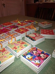 Disney coasters - ceramic tiles, mode podge, shellac coating and disney scrapbook paper