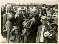 "Women and children on the Birkenau arrival platform known as the ""ramp"". The Jews were removed from the deportation trains onto the ramp where they faced a selection process - some were sent immediately to their deaths, while others were sent to slave labor."