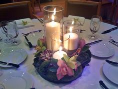 Succulents, Orchids, and Candles Centerpiece