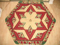 Quilted Christmas Tree Skirt Is machine pieced using quality 100% cotton fabric by Hoffman with beautiful red poinsettia with red, green and golds.   Your tree will never look neglected before or after the presents are displayed under it with this beautiful heirloom tree skirt wrapped around the base of it.  Makes a fabulous present for someone's birthday, anniversary and how wonderful for newlyweds first Holiday together when given as a Wedding present.   #quiltsyteam