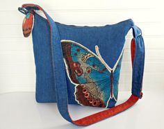 One of Kind Crossbody Bag for the Women who loves to have something special just for her. You cant ever go wrong with Denim - and honestly who doesnt love a butterfly? You may just love the retro hippie look with a touch of the bohemian style - if so, this is a perfect larger size purse for you. Wear this as a shoulder bag, a crossbody purse, a great take me to work messenger tote bag. Slings perfectly across your body and has an adjustable strap so it can fit to your height and comfort…