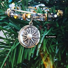 ALEX AND ANI Cosmic Balance Charm Bangle | Moon and sun, yin and yang: the balance of nature is essential. One force without its opposite is powerless. The moon reflects the light of the sun, illuminating the night when life rests and restores itself. Manifest your dreams with the power of masculine and feminine energy. When both align, all is possible.