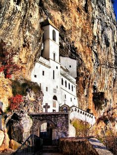 Ostrog Monastery in Montenegro. The Monastery of Ostrog is a monastery of the Serbian Orthodox Church placed against an almost vertical background, high up in the large rock of Ostroška Greda, in Montenegro. It is dedicated to Saint Basil of Ostrog.