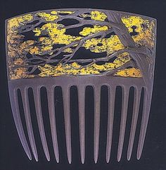 René Lalique - Rustling Tree Hair Comb. Carved Horn with Gold Leaf or Enamel. France. Circa 1900.