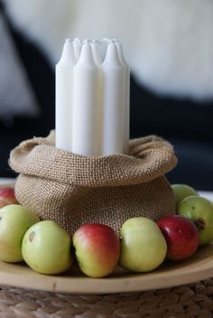Lughnasadh centerpiece. Use wheat or autumn colored candles instead of white.