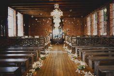 wood beams. exposed brick. chandelier. industrial chic.