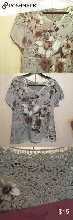 Neutral Floral Top with Crochet Back I bought this online for work. Worn a few times. Another item I just don't care for how it fits on me. The material is very clingy. In excellent condition Laura Scott Tops Tees - Short Sleeve