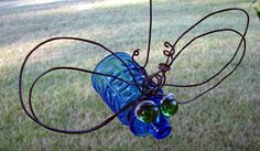 BOTTLE BUG... BOTTLE, WIRE FOR WINGS,  WASHERS AND 1/2 MARBLES FOR EYES, GLUE, AND YOUR IMAGINATION