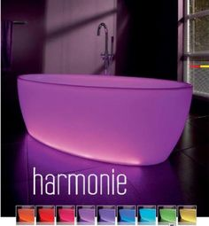 Luv this bath tub ... purple light up www.homezinterior.com ... how peaceful would this be?