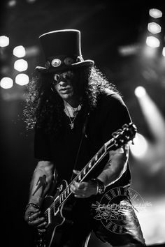 Slash Best Picture For Musical Band playing For Your Taste You are looking for something, and it is going to tell you exactly what you are looking for, and you didn't find that picture. Axl Rose, Guns N Roses, Heavy Metal, Saul Hudson, Rock Poster, Best Guitar Players, Best Guitarist, Entertainment, Music Bands