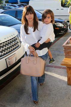 Kourtney Kardashian's White, Loose Shirt; Jeans; And, Some Leopard Flats! Stylish Mom Indeed.