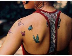 Design for a shoulder tattoo: a swarm of butterflies. This image doesn't belong…