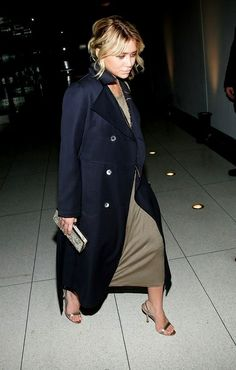 the brass colour of the dress, coat buttons and shoes
