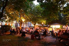 Lighted  beer garden under Trees - Biergarten iunter Baeumen n der Adolfsallee bei Abenddaemmerung, Wiesbaden, Hessen, Deutschland   I Lighted  beer garden under Trees  in Adolfsallee at Dusk, Wiesbaden, Hesse, Germany, Europe