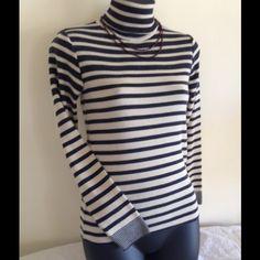 "TURTLENECK SOFT LIGHTWEIGHT LONG SLEEVE SWEATER Turtleneck light weight very soft long sleeve sweater.  Shoulder to hem 22"", shoulder to sleeve 22"" and armpit to armpit 15"". Aima+saie  Sweaters Cowl & Turtlenecks"