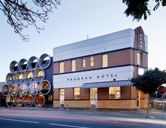 """Take a look at renewed Prahan Hotel in Melbourne, Australia. Techné Architects made a design y adding an extension that uses oversized concrete pipes. """"The Prahan Hotel is Architecture Design, Architecture Awards, Victorian Architecture, Australian Architecture, Commercial Architecture, Amazing Architecture, Melbourne Pubs, Melbourne Australia, Architects Melbourne"""
