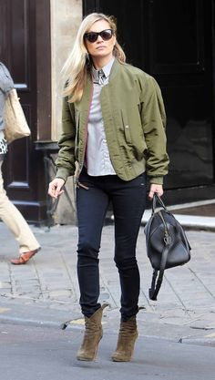 ✶In Paris, Vogue saw supermodel Kate Moss take to the streets in a seriously cool mash-up of urban classics. Her military-inspired bomber jacket was the focal point here, with a high-collared blouse. Grounding the ensemble were suede booties in a muted shade of olive, while skinny black Rag & Bone jeans and a micro duffle added an air of insouciance. With the season in flux, channel La Moss with the reworked bomber jacket in an army-appropriate shade✶