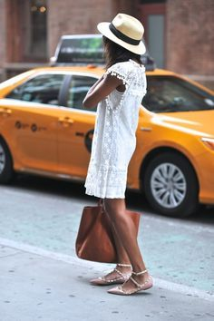 New York girl in white lace and pom pom dress, panama straw hat, tan leather bag and Valentino studded flats - Summer city outfit ideas and inspiration - #fashion #outfit