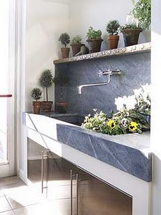 If we add an outdoor sink to the deck, I like this idea...