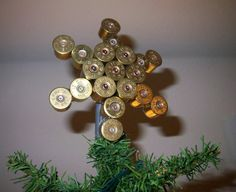 Oh the Songer tree shall have this !Shotgun Shell Christmas Star - I'm terribly tempted to have a redneck Christmas tree! Redneck Christmas, Christmas Star, Christmas Tree Toppers, Country Christmas, Xmas Tree, Christmas Decorations, Christmas Ornaments, Merry Christmas, Antler Christmas Tree