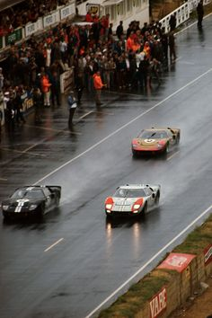 The Le Mans 24 Hours; Le Mans, June Streaking toward the end of the race, the top three Ford Mk. IIs leave sheets of spray behind them. Leading is the eventually winning n. 2 car of. 24 Hours Le Mans, Le Mans 24, F1 Wallpaper Hd, Car Wallpapers, Moto Guzzi, Ford Gt40 1966, Ford Le Mans, Ferrari, Bugatti
