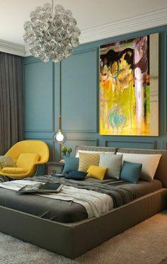 décor en gris, jaune et bleu, chambre bleu canard, suspension design, fauteuil jaune, tapis et lit gris, tableau art mural. mur bleu canard