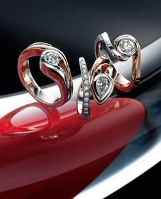 three 18k red and white gold diamond rings