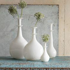 opal vases inspired by Roman oil and perfume bottles