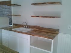 Blue Pine live edge counter tops and shelving from SNWWOOD