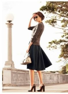 Navy skirt with brown cardigan. Brown Heels