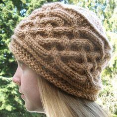 Saxon Braid Cabled Cap - PDF pattern via Etsy. The braid might look nice as a kilt hose cuff.