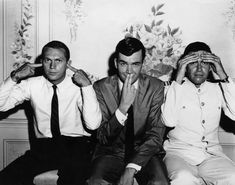 Steve McQueen, Jim Hutton, and Jack Mullaney clowning around on the set of The Honeymoon Machine. | 21 Candid Photos Of Old Hollywood Celebs