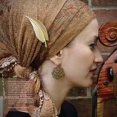 Andrea Grinberg, cellist and Jewish hair wrapping instructor, was born in Canada and is also a citizen of Israel. In 2013, she started Wrapunzel, a website and community for women all over the world to connect through the wearing of headscarves. Andrea loves to cook, bik..