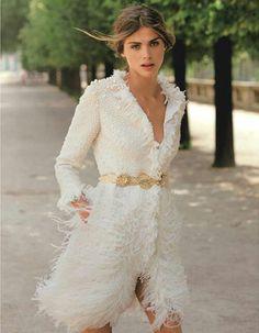 White coat. Gold belt. Beading. Fur.