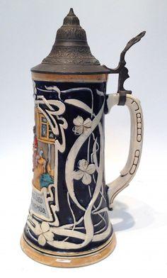 "German Ceramic Beer Stein                          A 10 1/2"" .5 liter ceramic beer stein in the art nouveau style."