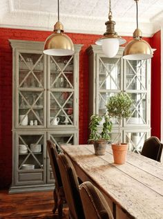 Designers 12 Favorite Shades of Red Paint {and a gift!} - laurel home  | I like these two cool china cabinets side by side in this semi-rustic dining room by Katie Brown