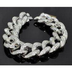 Diamond bracelet for  Men:  It is a 10k solid white gold 16ct Diamond bracelet.  It is a Custom made Cuban/Curb Link bracelet. You can it this beautiful one only in $17995.