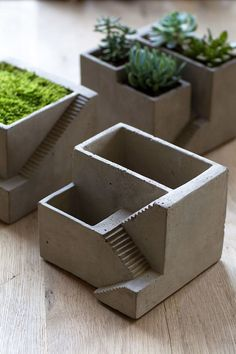 """Simple yet intriguing cement planter features a staircase design, reminiscent of a creation by M.C. Escher. (Plant not included.) Dimensions: 6.75"""" square x 5.25"""" high."""